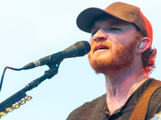 Eric Paslay performs on stage. Country acts Paslay and Parmalee will perform Friday at Sunfest.