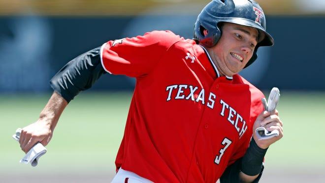 Texas Tech's Michael Davis (3) runs around third base during an NCAA college baseball game against Texas, Saturday, May 5, 2018, in Lubbock, Texas. (Brad Tollefson/Lubbock Avalanche-Journal via AP)