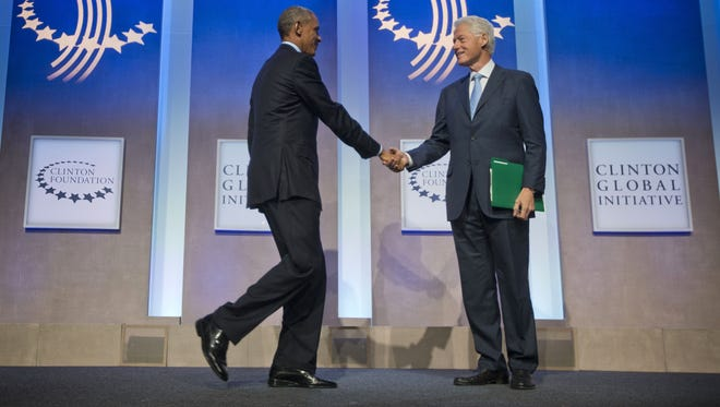 President Barack Obama is greeted by former President Bill Clinton at the Clinton Global Initiative in New York, Tuesday.