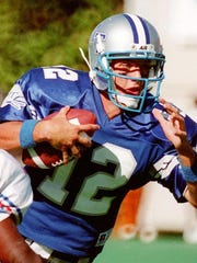 -  -MTSU quarterback Kelly Holcomb eludes a Tennessee State defensive back in their October 3, 1993 meeting at Dudley field. Photo by Freeman Ramsey - staff. 10/3/93.