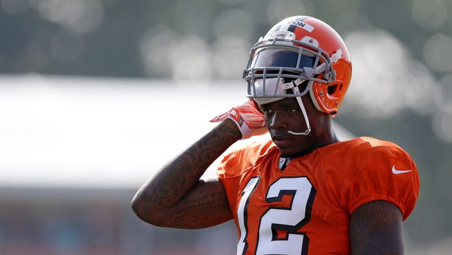 Cleveland Browns wide receiver Josh Gordon rests during practice at the NFL football team's training camp Monday, Aug. 4, 2014, in Berea, Ohio.
