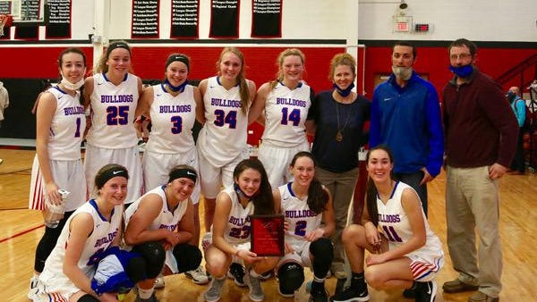 The Pretty Prairie High School girls basketball team poses for a picture after winning the Falcon Classic on Saturday.