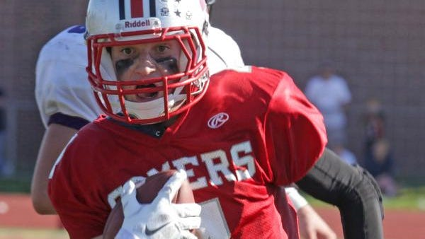 Tyler DeVito of Somers runs past the John Jay defense to score a 60-yard touchdown on a reverse on Saturday.