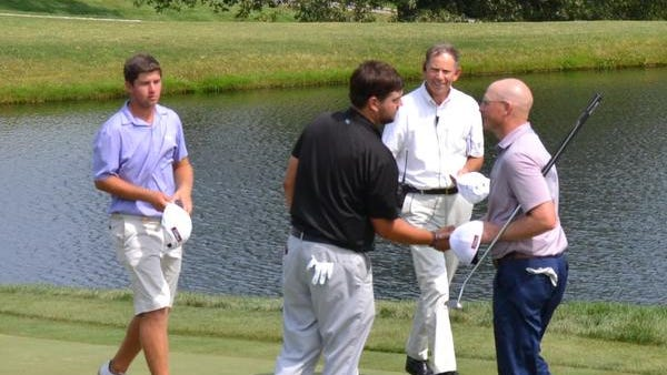 Winged Foot assistant Grant Sturgeon, right, shakes hands with Mike Ballo Jr. on the 18th green at Trump National Bedminster on Thursday as Cameron Young, left, looks on. The 36-year-old Sturgeon shot a final-round 71 to win the 99th Met Open Championship by three shots.