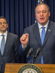 Jeff Hoover, right, speaks as Matt Bevin looks on at an October 2017 press conference about pension reform.