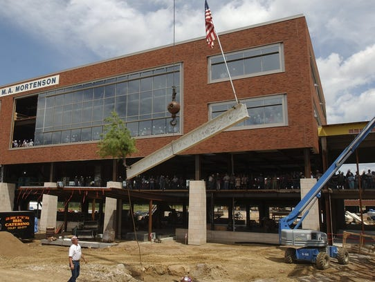 Workers put the final steel beam in place at Ministry