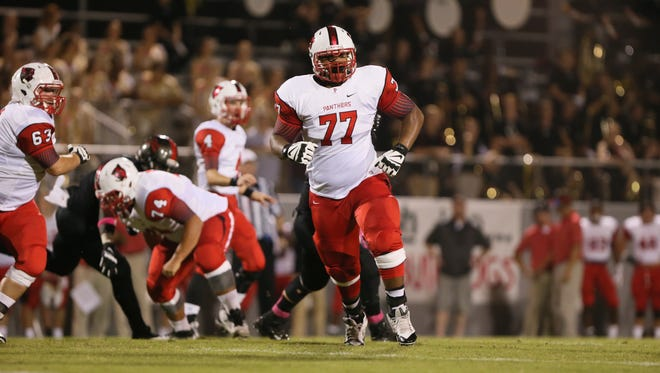 Petal offensive lineman Javon Patterson (77) looks to make a block. Brandon and Petal played an MHSAA Class 6A football game on Friday, October, 10, 2014 in Brandon. Photo by Keith Warren