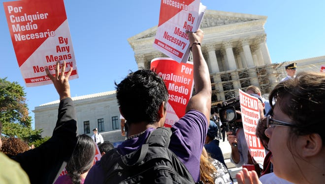 Protesters in support of affirmative action gather outside the Supreme Court on Oct. 15.