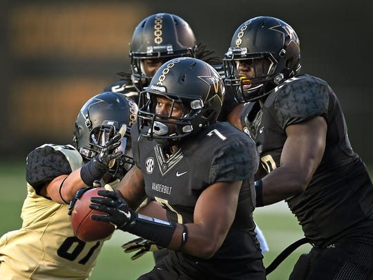Safety Emmanuel Smith recovers a fumble and runs it back for a touchdown during  Vanderbilt's Black & Gold spring game Friday night at Vanderbilt Stadium.