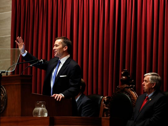 Missouri Lt. Gov. Mike Parson, right, listens as Gov. Eric Greitens delivers the annual State of the State address to a joint session of the House and Senate, Wednesday, Jan. 10, 2018, in Jefferson City, Mo.