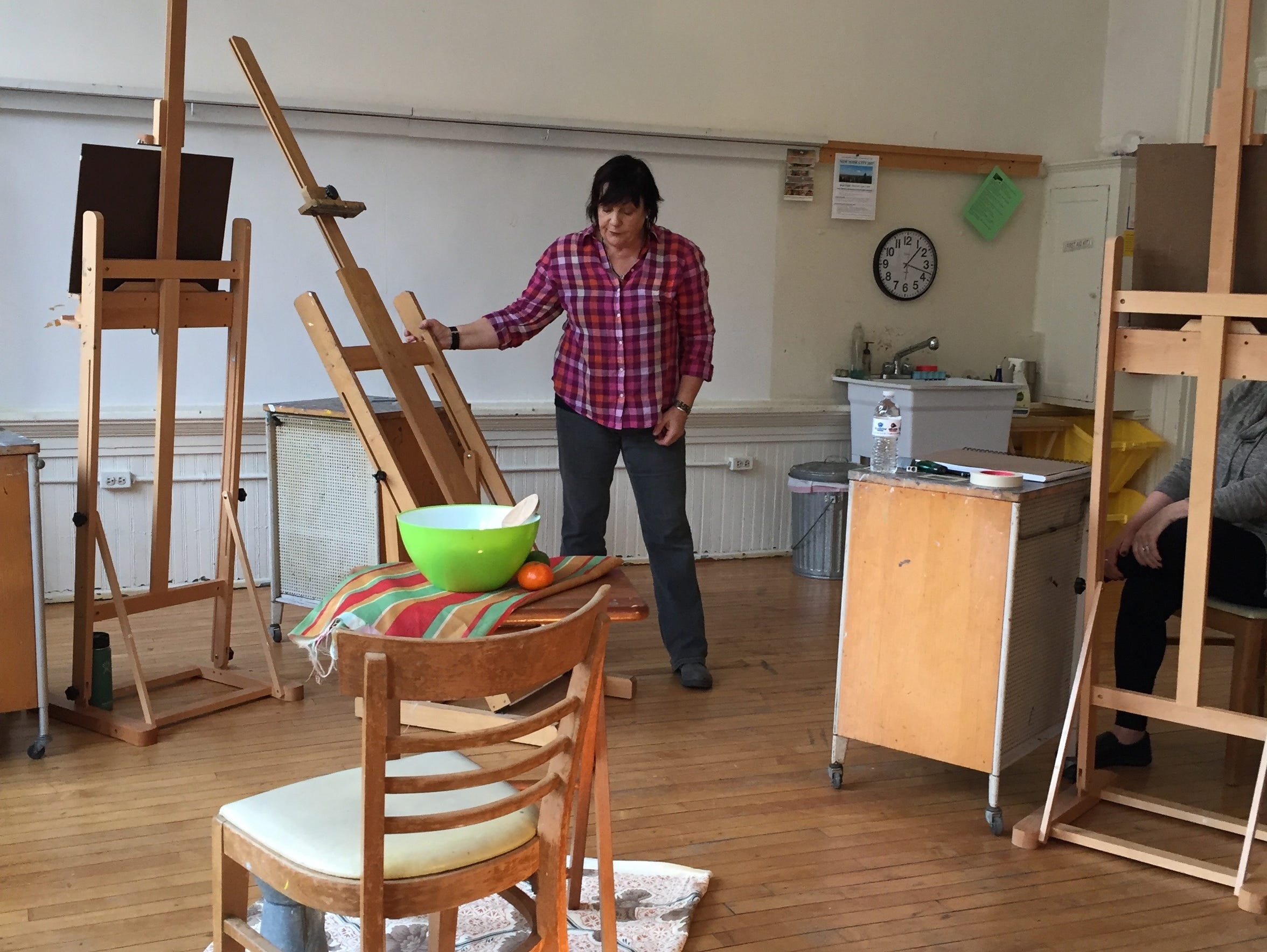 Art instructor Janly Jaggard teaches students how to