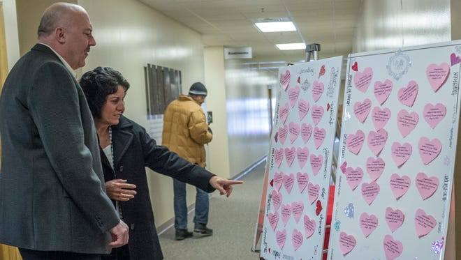 Mike and Joanne Bennett of Lansing find their name on the heart board at the entrance to the World Marriage Day celebration at St. Gerard Catholic Church Sunday, February 14, 2016.