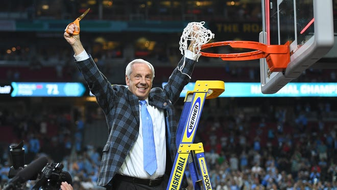 Roy Williams cuts down the nets Monday night after winning his third national championship as coach of the Tar Heels.