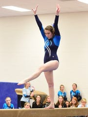 Bri Rhoad competes on the balance beam earlier this