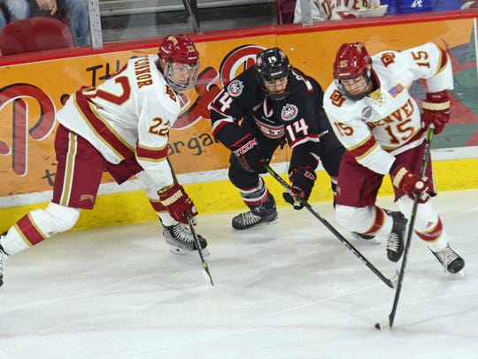 St. Cloud State's Patrick Newell (14) goes after the