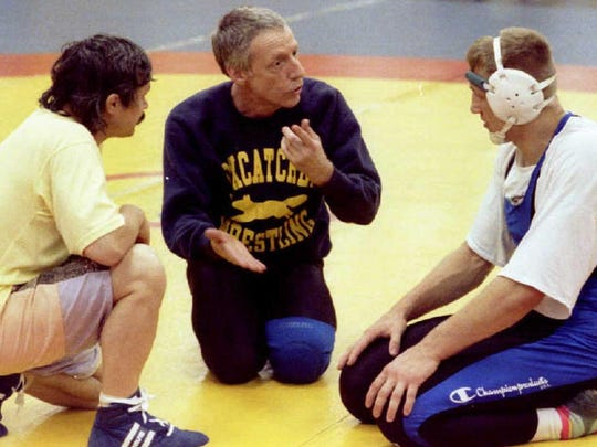This May 1992 photo shows John E. du Pont talking with wrestlers at an Olympic training facility he operated at Foxcatcher Farm.