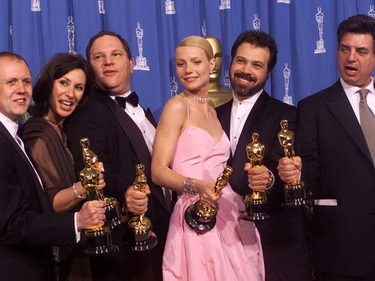 "From left to right, David Parfitt, Donna Gigliotti, Harvey Weinstein, Gwyneth Paltrow, Edward Zwick and Marc Norman all celebrate after receiving the Oscar for best picture for ""Shakespeare In Love"" during the 71st Annual Academy Awards Sunday, March 21, 1999, at the Dorothy Chandler Pavilion of the Los Angeles Music Center. Paltrow won the Oscar for best actress in the movie."