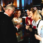 Kyleigh Grim, 25, of Gettysburg shakes hands with Prince Charles at the Buckingham Palace. Grim performed for the prince as part of an event for the Royal Welsh College of Music & Drama.