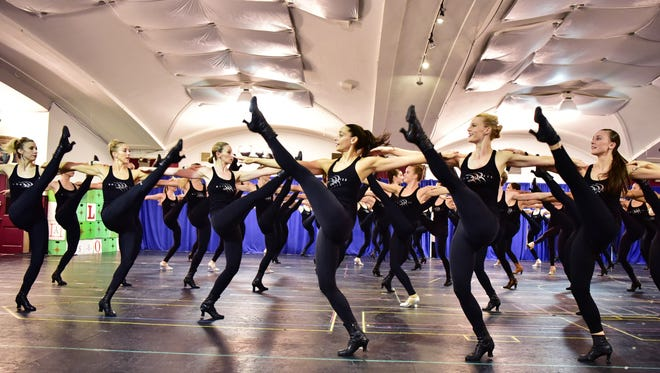ockette Nicole Baker of Upper Saddle River, NJ, (center, 1st dancer facing left) dances during a press rehearsal in Manhattan on Thursday. The Rockettes, a precision dance company, have performed at Radio City Music Hall in Manhattan since 1932. Photo: Marko Georgiev/Staff