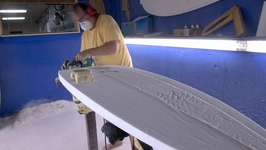 Rick Bullock, the resident shaper at Waterboyz in downtown Pensacola, starts work on a new custom surfboard in the shaping room.