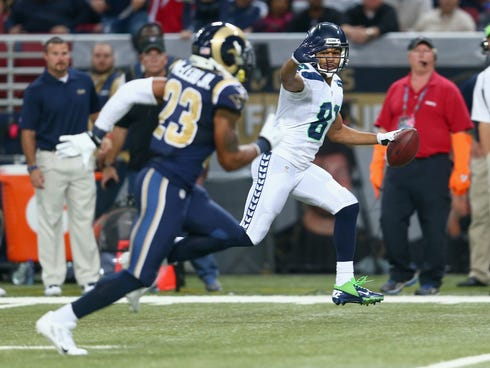 Golden Tate of the Seattle Seahawks celebrates as he runs for a touchdown during the 14-9 victory over the the St. Louis Rams at Edward Jones Dome.