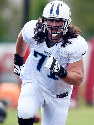 Offensive lineman Dennis Kelly was acquired in a trade with the Eagles for receiver Dorial Green-Beckham.