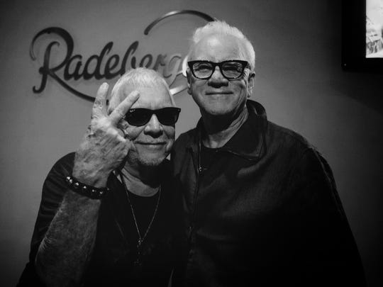 Eric Burdon with Malcolm McDowell after a show in New York City.