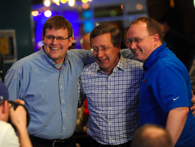 Mayor Mike Huether poses for a picture with Brad Green (left) and Larry Luetke on Tuesday, April 8, 2014 during a campaign party at the downtown Hilton Garden Inn.