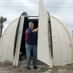 In this 2010 photo, Bob Nolan steps out of the Air Force tracking station dome when it was located behind Brevard County Fire Rescue Station 64 near Melbourne Beach.