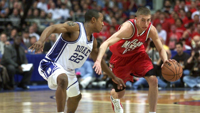 Steve Blake of Maryland drives around Jason Williams of Duke during the semifinal of the Men's NCAA Basketball Final Four tournament at the Metrodome in Minneapolis, Minnesota in March of 2001.