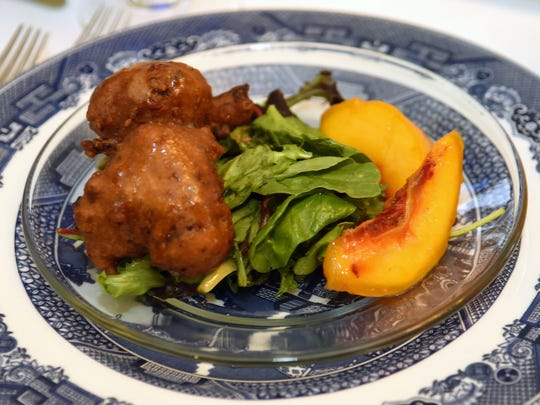 Cindy Gleason Johnson's first course was a Oyster Beihnet on a bed of greens with a Peach Pepper Vinairgrette and Pickled Peaches.