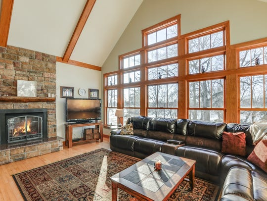 The family room has a large double-sided stone fireplace