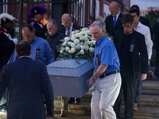 Pallbearers bring out a casket from the Catherdral of St. John the Evangelist after the Mass of Burial for Unclaimed Bodies in Lafayette Thursday evening.