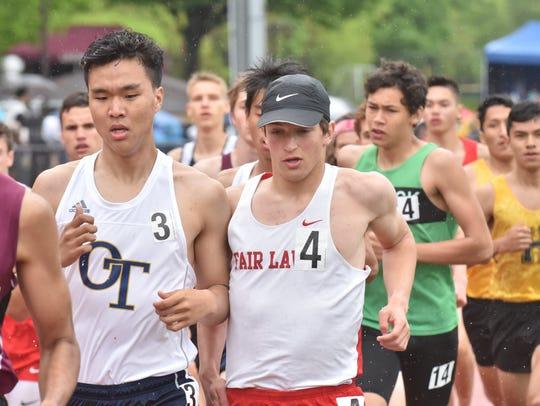Fair Lawn Jonathan Marcus, #4, winner in 800m, runs
