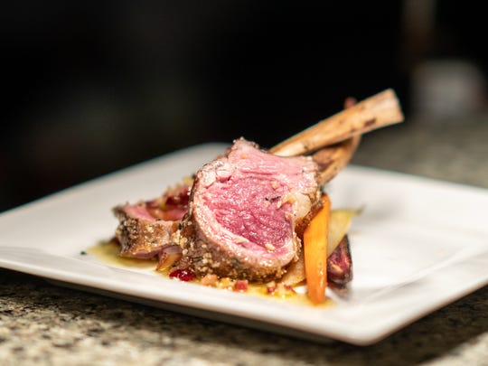 Panko- and herb-crusted lamb lollipops with bacon at
