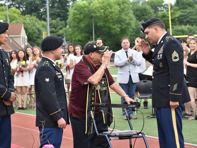 Vito Trause, a 92-year-old veteran, receives his high