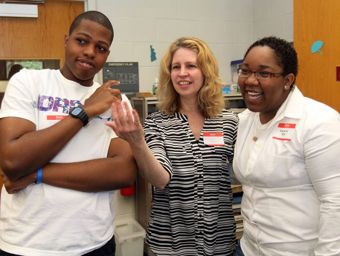 Michele Knepper, center, who is with the work study program attends the breakfast with work study students Shaquil Rivers, left, who works at The Chelsea At Bridgewater and a day care center, and Sheneice Fox, who works at Quick Check. The Bridgewater-Raritan High School Work Study and Employment Orientation Programs host an annual employer appreciation breakfast to thank local businesses for hiring students, June 06, 2014. Bridgewater NJ. photo by Kathy Johnson  BRI 0607 B-R Breakfast