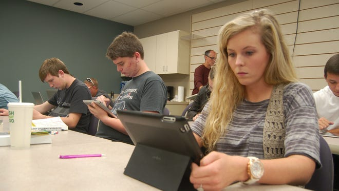Renea Foster, a 20-year-old aspiring dental hygienist, (front center), takes a midterm Thursday at the Arkansas State University-Mountain Home. Foster is taking two online courses this Fall — she said online courses allow her to get her work done at her convenience.