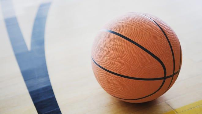 Basketball on court.