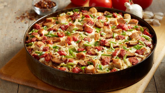 BJ's Restaurant and Brewery is known for its deep dish pizzas, such as this Cajun version.