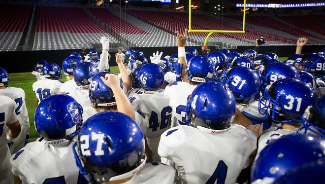Chandler High's football team prepares for the state championship game on Nov. 28, 2014, in Glendale.