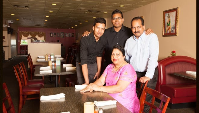 The Chalasane family operates Sai Ram Indian Cuisine in Appleton. Krishna (right) and Kumari (front) own the restaurant. Their sons Shavan (left) and Neehar (center), have worked in the restaurant.