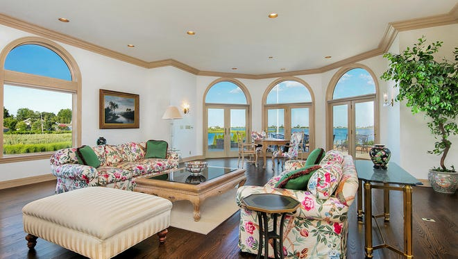 The living room at 15 Edwards Point Road in Rumson.