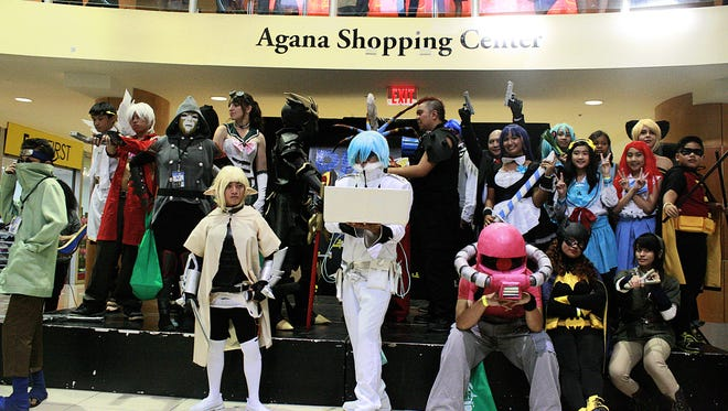 Above: Participants show off their costumes at Recon 2014, held Aug. 9-10 at the Agana Shopping Center.