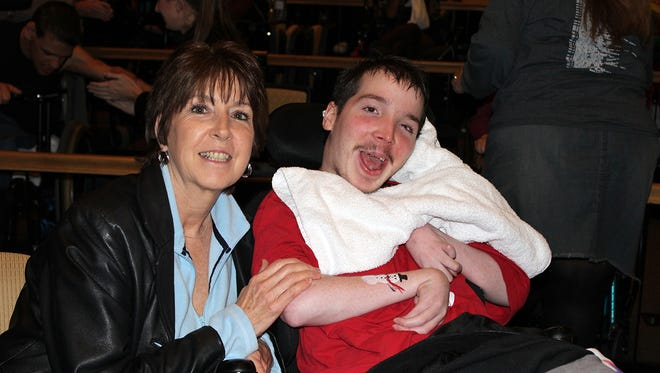 Student Daniel Gaudreau and his mother, Regina, a resident of Hillsborough, enjoying the Holiday Express show.