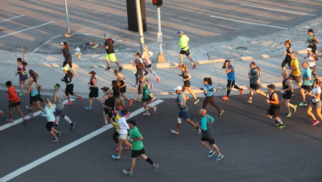 Athletes from all over participate in the 2016 Hooters Half Marathon on Sunday.