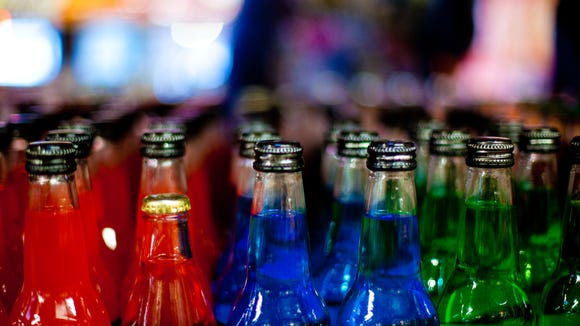 Rows of colorful sodas in a Rocket Fizz location.
