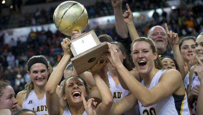 St John Vianney celelbrate with their trophy.SJV vs Manasquan Girls  Basketball Tournament of Champions Final in Trenton NJ on March 21, 2016