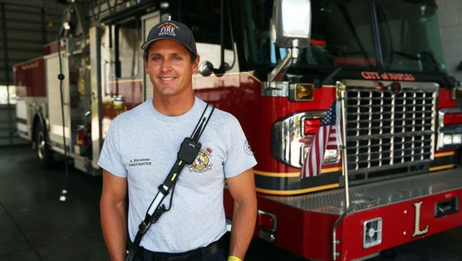 Firefighter Austin Bleiweiss at the Naples (Fla.) Fire Station on Tuesday, April 26, 2016. Bleiweiss helped save a man's life who went in to cardiac arrest during a flight from Puerto Rico on April 19, 2016.