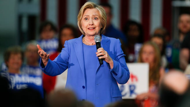 Secretary of State and presidential hopeful Hillary Clinton speaks at the Union of Carpenters and Millwrights training center in Louisville, Ky. on Sunday afternoon. May 15, 2016